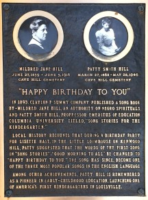 """This small plaque in the bushes on a corner in Louisville, is the only current monument to the """"Happy Birthday Sisters."""""""