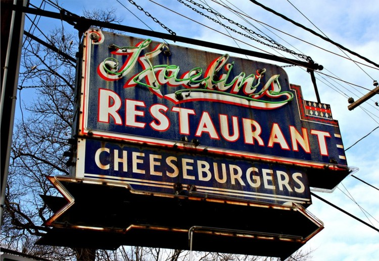 A sign hangs outside the old Kaelin's Restaurant in Louisville, KY, home to the first cheeseburger.